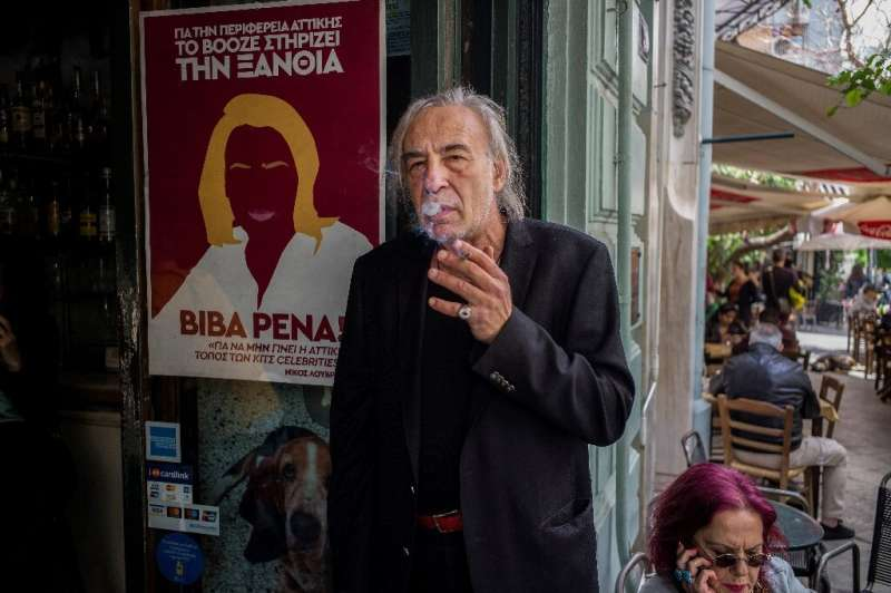 Nikos Louvros, an Athens bar owner and proponent of smokers' rights, provides ashtrays at his Booze Cooperativa venue where cust