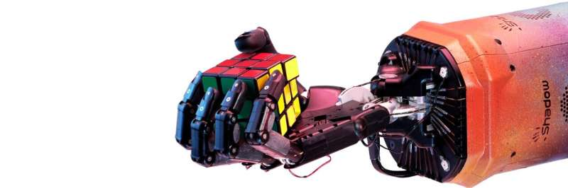 OpenAI's robot hand makes the moves for Rubik's cube