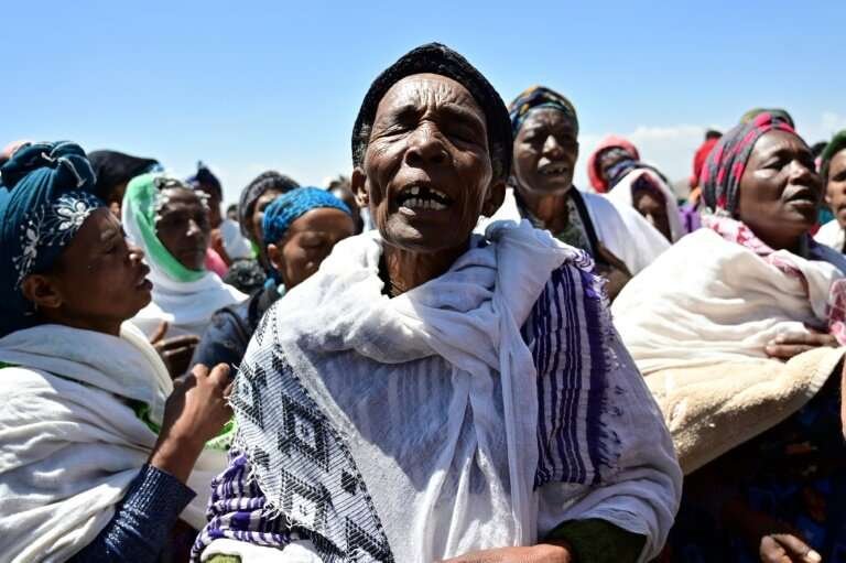 Oromo women perform a traditional chant at the crash site at Hama Quntushele village, in Oromia region