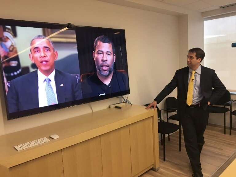 """Paul Scharre of the Center for a New American Security looks at a """"deepfake"""" video of former US President Barack Obama"""