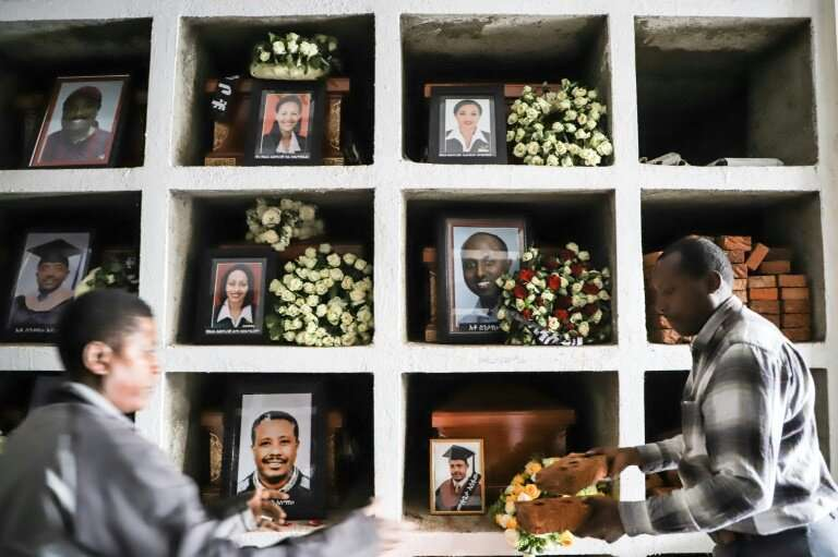 Portraits of victims from the Ethiopian Airlines Boeing 737 MAX crash are displayed during a mass funeral at Holy Trinity Cathed
