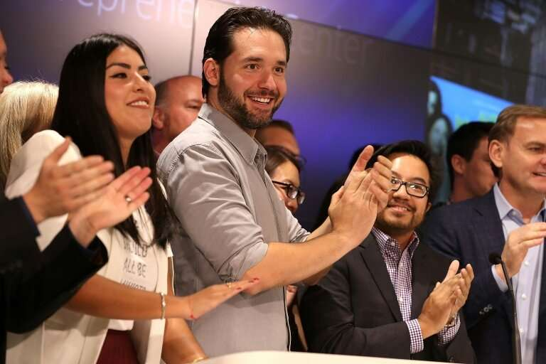 Reddit is expanding into Ireland—the company's co-founder Alexis Ohanian (C) is seen here before ringing the Nasdaq closing bell