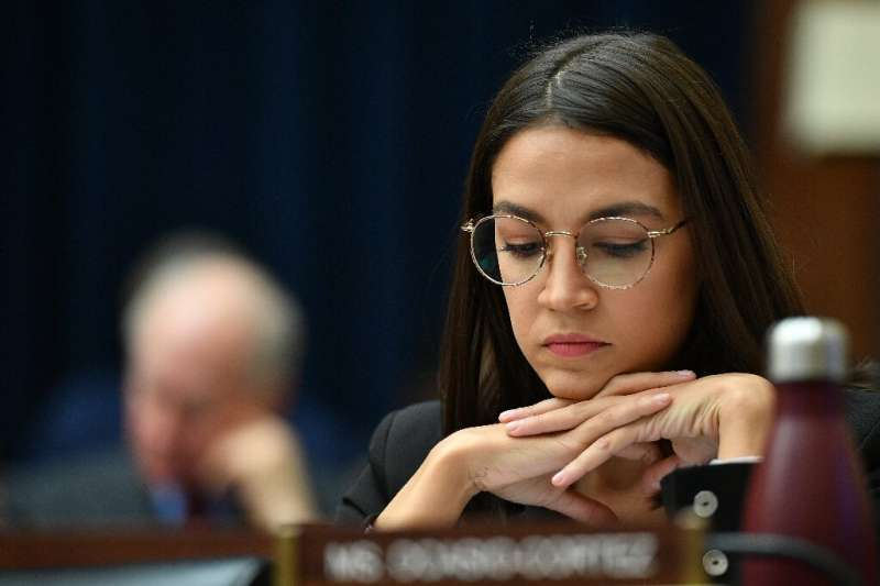 Rep. Alexandria Ocasio-Cortez listens as Facebook Chairman and CEO Mark Zuckerberg testifies before the House Financial Services