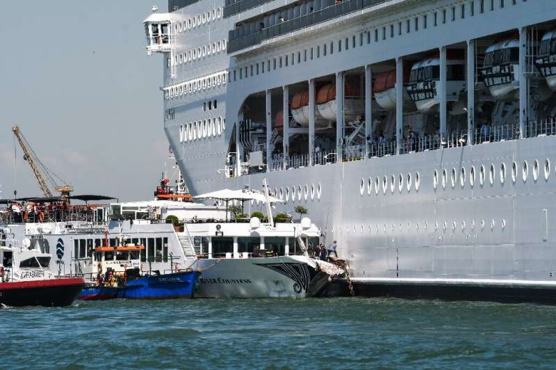 Rescue boats assist the damaged River Countess tourist boat after it was hit early on June 2, 2019 by the MSC Opera cruise ship
