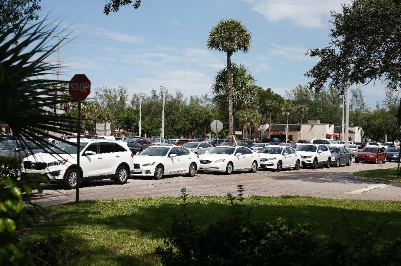 Residents line up for gas in preparation for Hurricane Dorian, in Pembroke Pines, Florida