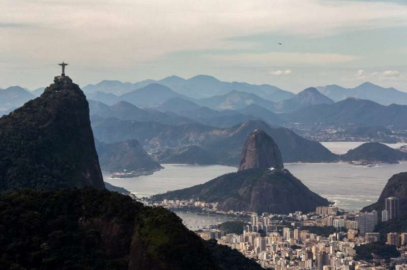 Rio's Christ the Redeemer statue and Sugarloaf Mountain are seen from the trail