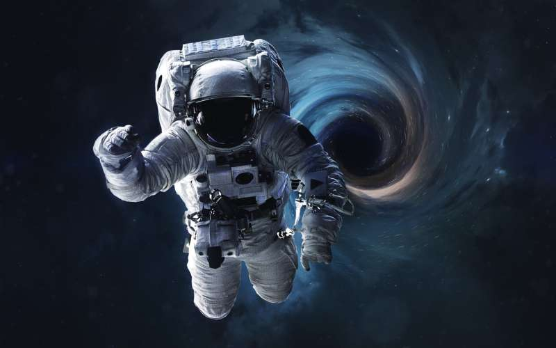 Rotating black holes may serve as gentle portals for hyperspace travel