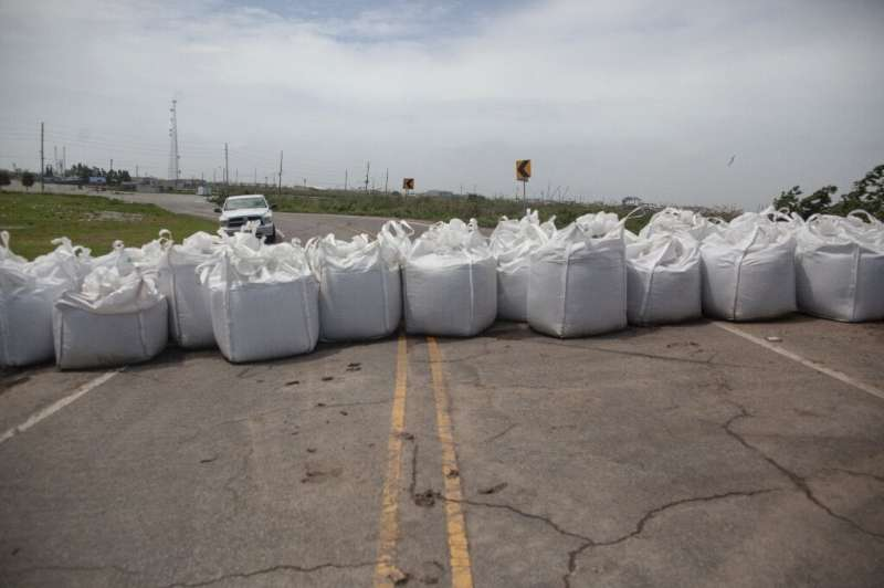 Sandbags block a road ahead of the arrival of Tropical Storm Barry on July 12, 2019 in Venice, Louisiana.