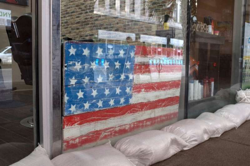Sandbags protect a barber's shop in New Orleans as the Gulf Coast braces for the arrival of Tropical Storm Barry, expected to st