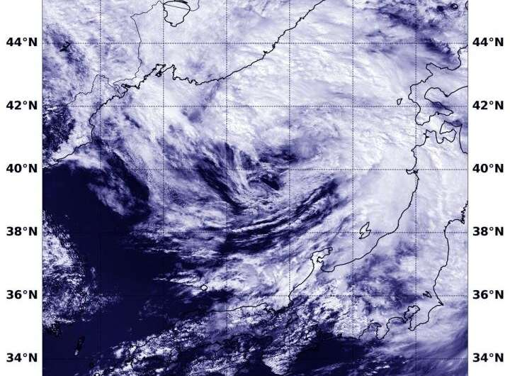Satellite view of tropical storm Krosa transition in sea of Japan