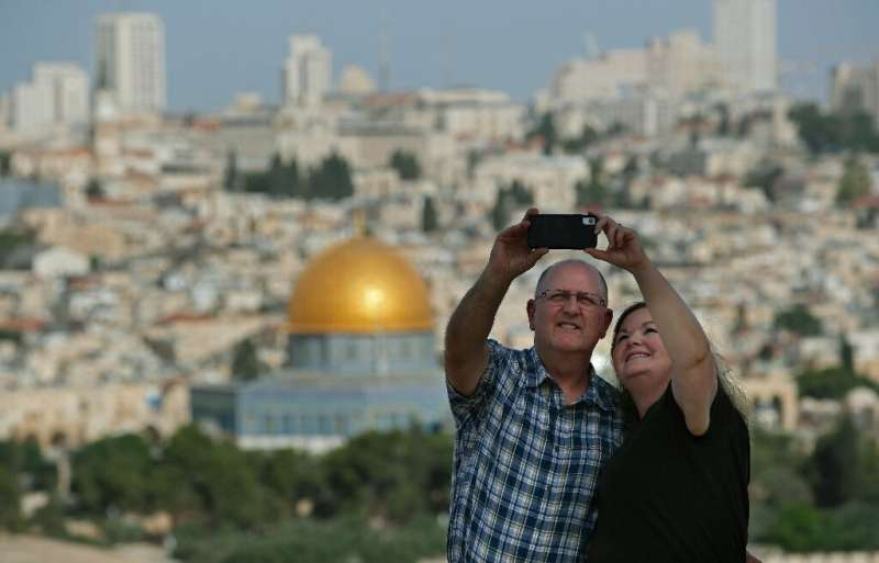 Selfies often feature spectacular backgrounds; here, a couple takes one in front of Jerusalem's Old City from the Mount of Olive