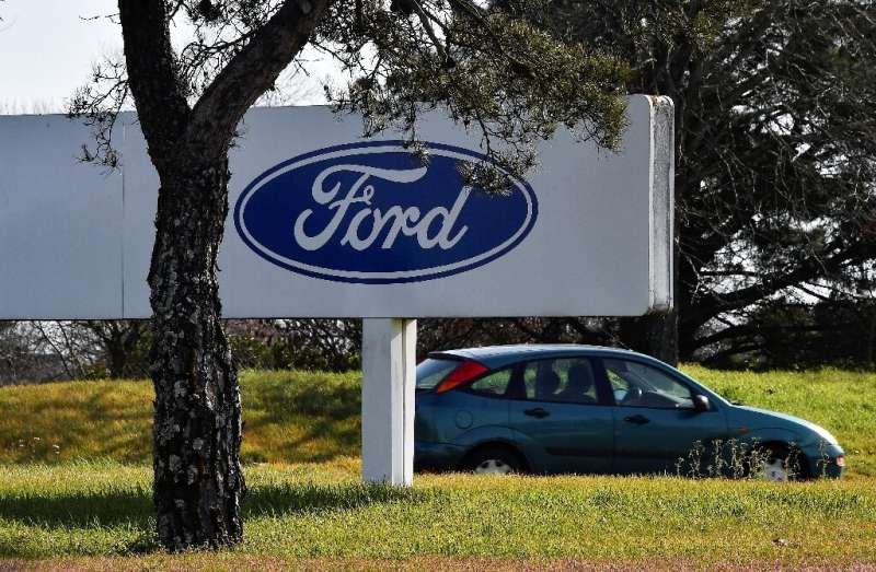 Shares of Ford fell sharply after it reported a steep drop in second-quarter earnings