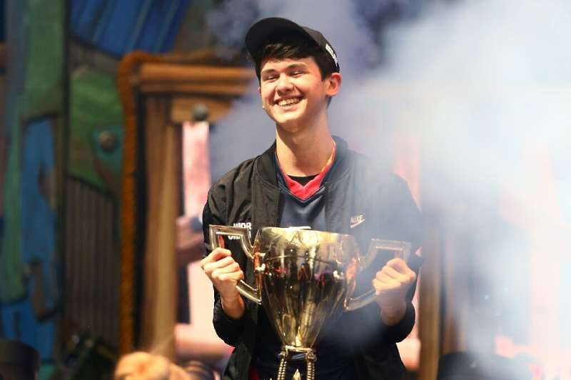 """Sixteen-year-old Kyle """"Bugha"""" Giersdorf is seen celebrating on July 28, 2019, after winning the Fortnite World Cup sol"""