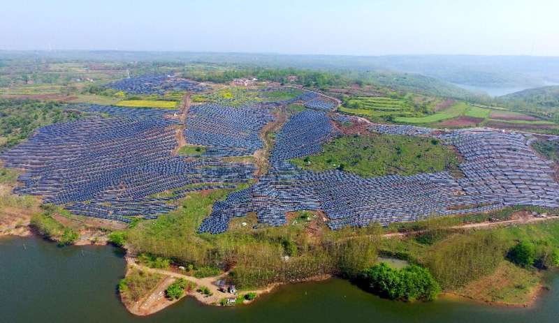 Solar photovoltaic modules on a hillside in a village in Chuzhou, in eastern China's Anhui province