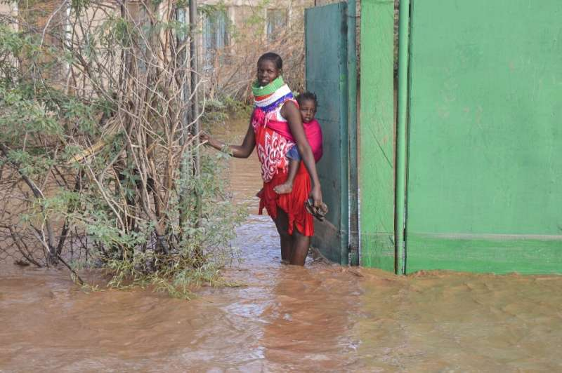 Some parts of northern Kenya received a year's worth of rain in a matter of weeks. A Turkana woman is shown here outside her hom