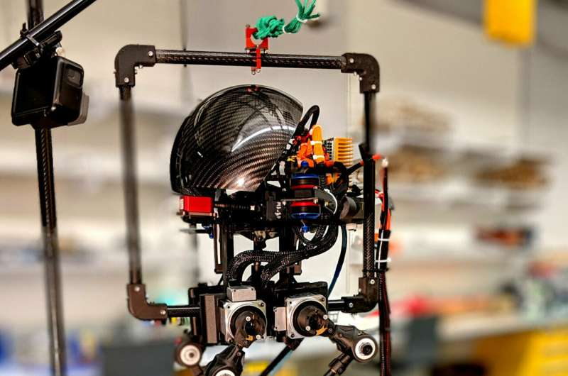 Some robots walk. Others fly. He built one that can do both.