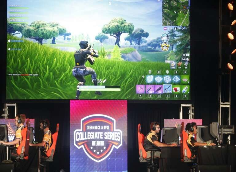 Students from Louisiana State University and The University of Washington compete in the online game Fortnite during DreamHack A