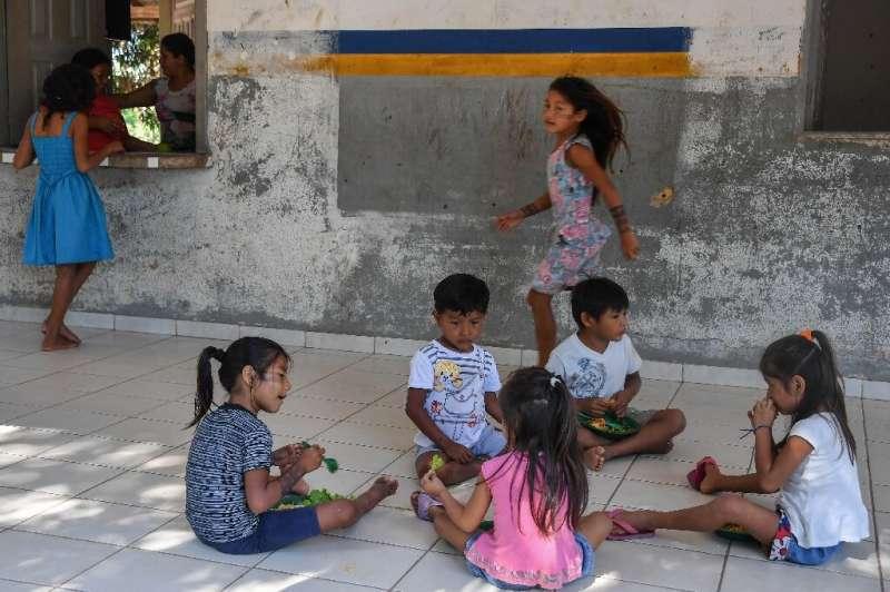 Students have lunch during a break at school in the Praia do Mangue indigenous reserve where Claudeth Gabriel Sau Munduruku work