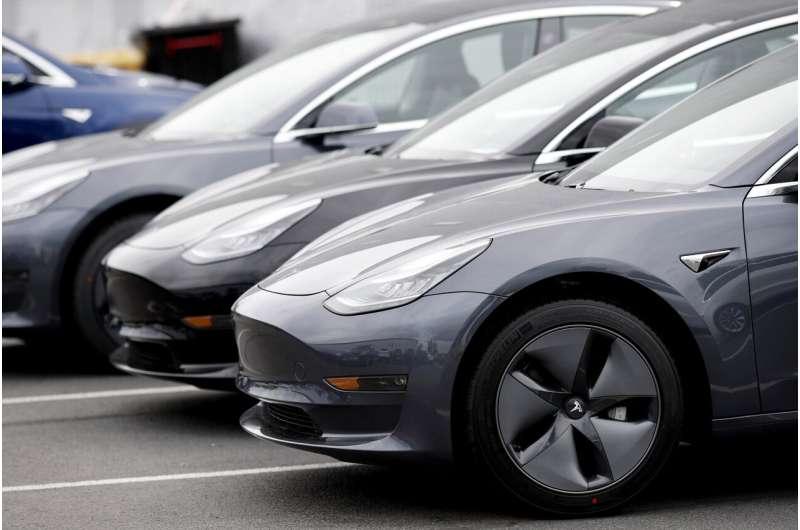 Tesla's car deliveries rebound, but challenges still abound