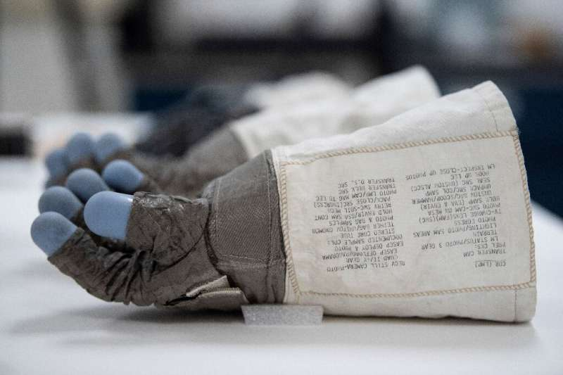 The blue silicon fingertips of Armstrong's glove have begun to degrade—a process that for now remains invisible to the naked eye