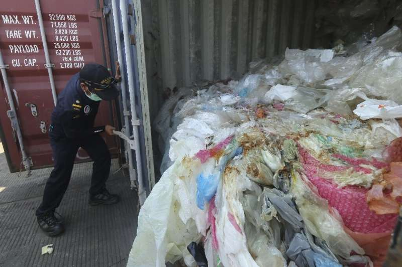 The containers were loaded with a combination of garbage, plastic waste and hazardous materials in violation of import rules, ac