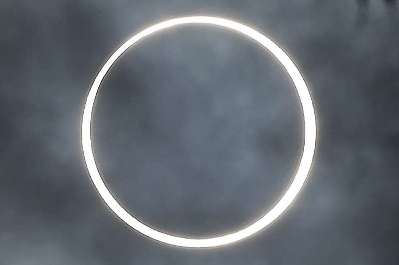 """The moon totally covers the sun in the rare """"ring of fire"""" solar eclipse as seen from the south Indian city of Dindigu"""