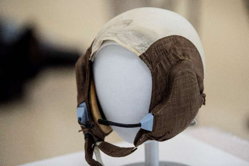 """The slightly yellowed """"Snoopy Cap"""" (formally known as a """"communications carrier"""") worn by Apollo 11 crew mem"""