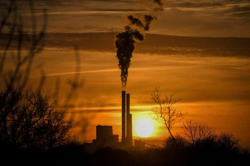 The sun rising over a coal-fired power plant in Cordemais, France