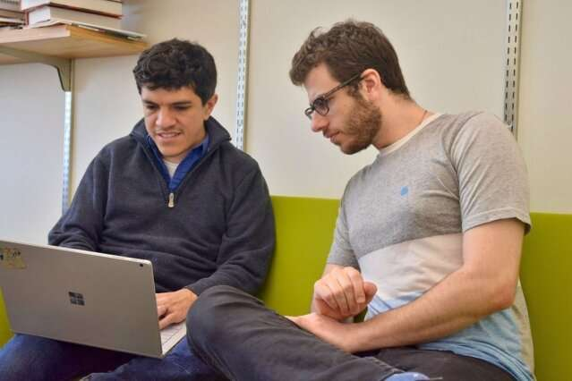 Toward artificial intelligence that learns to write code