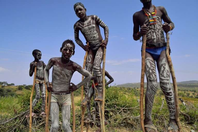 Traditionally mixed from clay, chalk, ash and cattle dung, the white or grey body paint is widely thought to help individuals mo