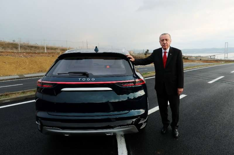 Turkish President Recep Tayyip Erdogan with one of the prototype electric vehicles that a domestic consortium of manufacturers c