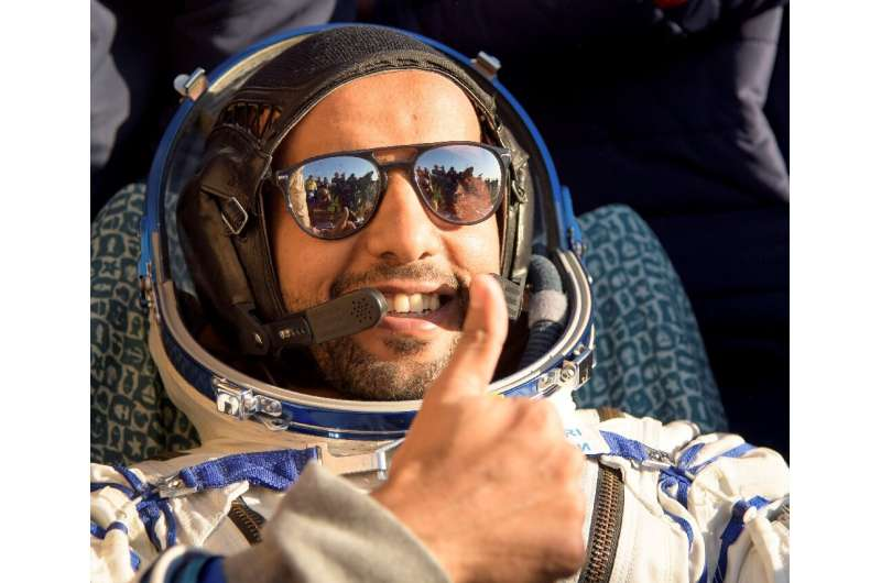 United Arab Emirates astronaut Hazzaa al-Mansoori gives a thumbs up shortly after the landing of the Russian Soyuz MS-12 space c