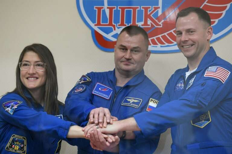 US astronauts Christina Kochand Nick Hague (R) and Russian cosmonaut Alexey Ovchinin are scheduled to travel to the Internation