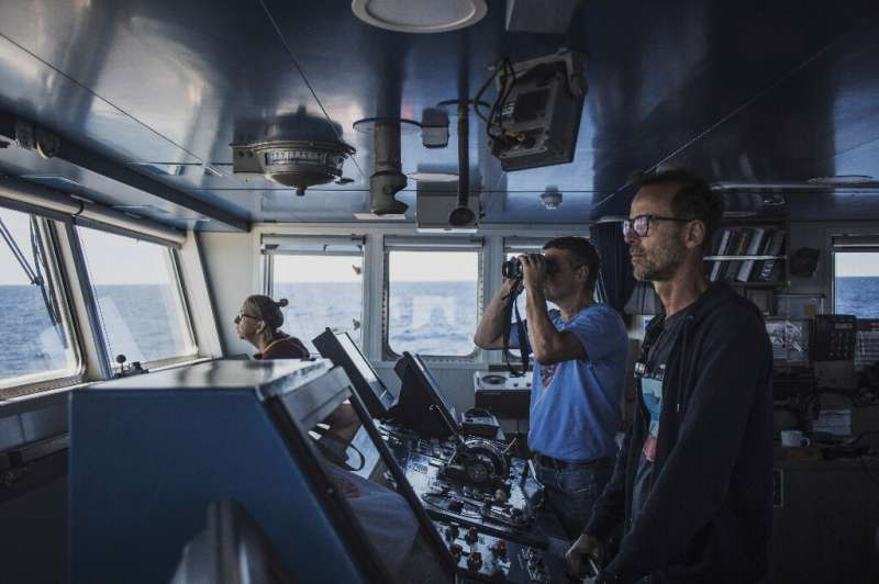 View from the bridge: Captain Mike Finchen, right, and marine biologist Thilo Maack, looking through binoculars
