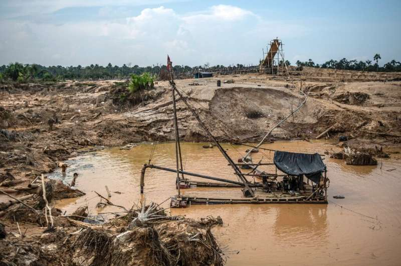 View of an illegal dredger used to extract gold using mercury near Puerto Maldonado