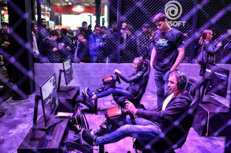 Visitors attend the 10th edition of the Paris Games week (PGW) show on October 30, 2019 at the Porte de Versailles exhibition ce