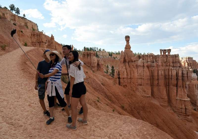 Visitors take a selfie in Bryce Canyon National Park, in the US state oi Utah