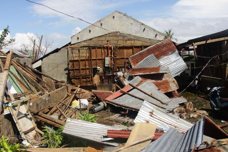 With gusts reaching 200 kilometres (125 miles) an hour, Typhoon Phanfone tore into houses including this one in Balasan town, Il