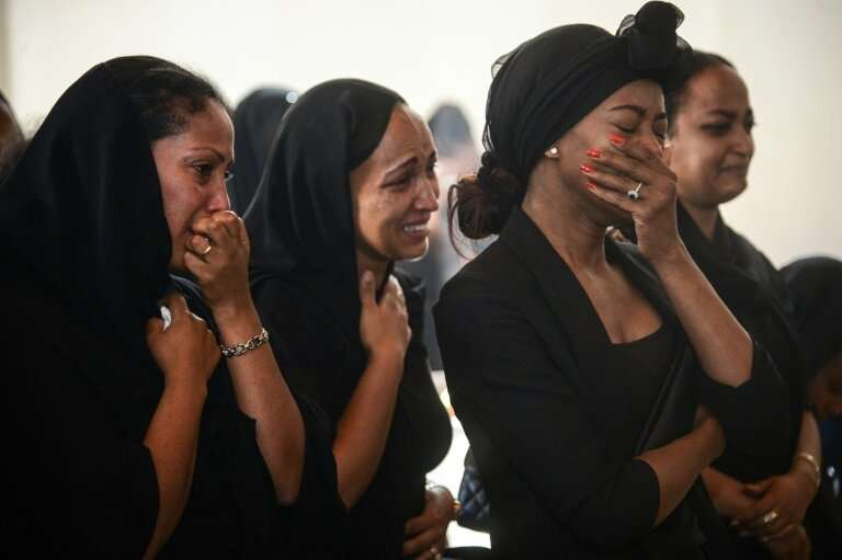 Women mourn during a memorial ceremony in Addis Ababa, Ethiopia on Monday March 11, 2019