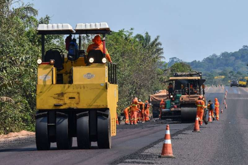 Workers pave the BR163 highway in Itaituba—President Jair Bolsonaro's government is eager to develop the Amazon to bolster Brazi
