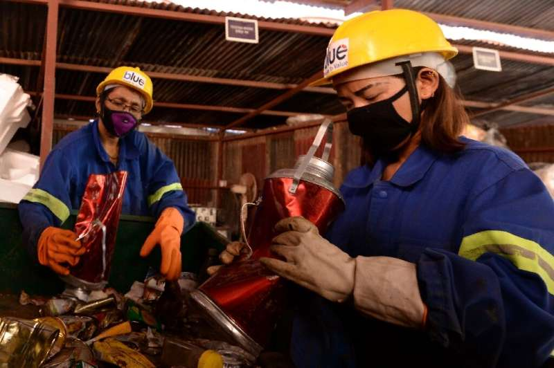 Workers there manually sorted the materials—with discarded bottles re-fashioned into household items