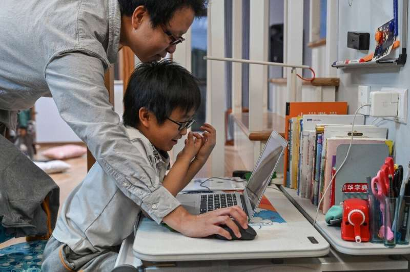 Zhou Ziheng's eight-year-old son Vita teaches an online coding class used by adults and children in China