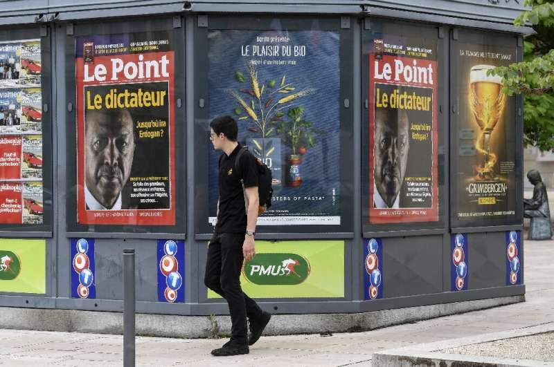 A 2018 picture shows a newsstand in France, where authorities have ordered Google to negotiate payments to media to comply with