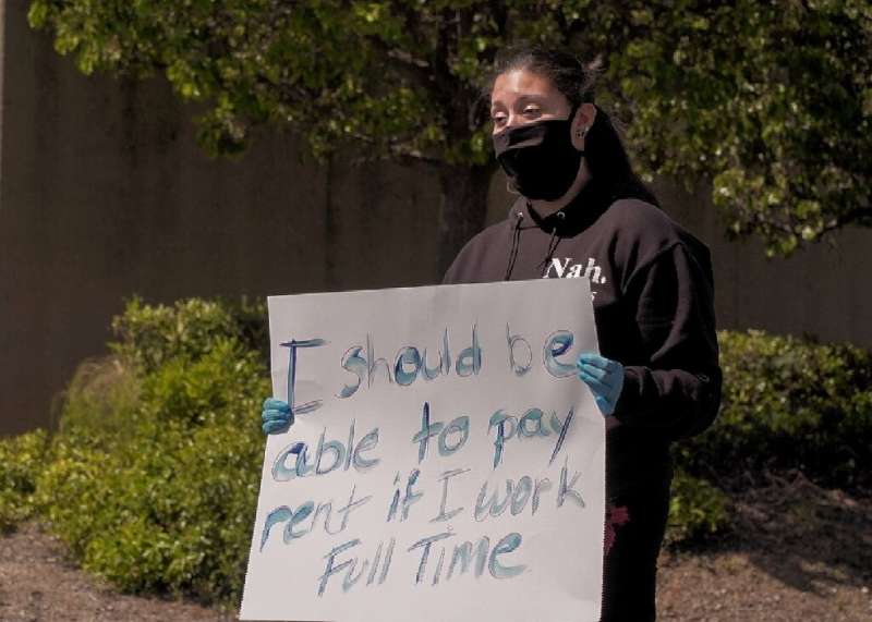 Adrienne Williams protests in front of an Amazon warehouse in Richmond, California, on May 1, 2020