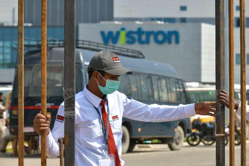 A security guard at the entrance of the Taiwan-run iPhone factory at Narsapura, near Bangalore