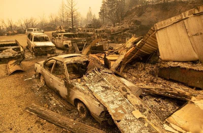 Burned vehicles smoldering in Fresno County, California