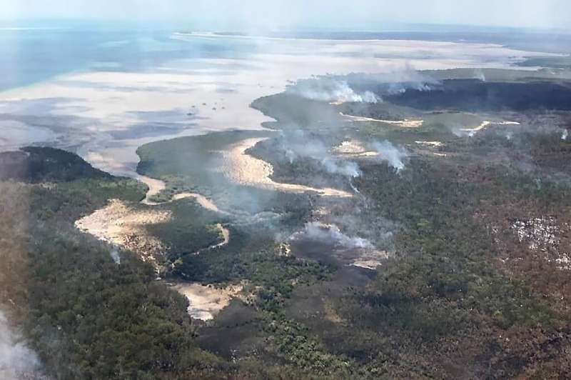Bushfires that have burned more than half of  UNESCO world heritage-listed Fraser Island are suspected to have been started by a