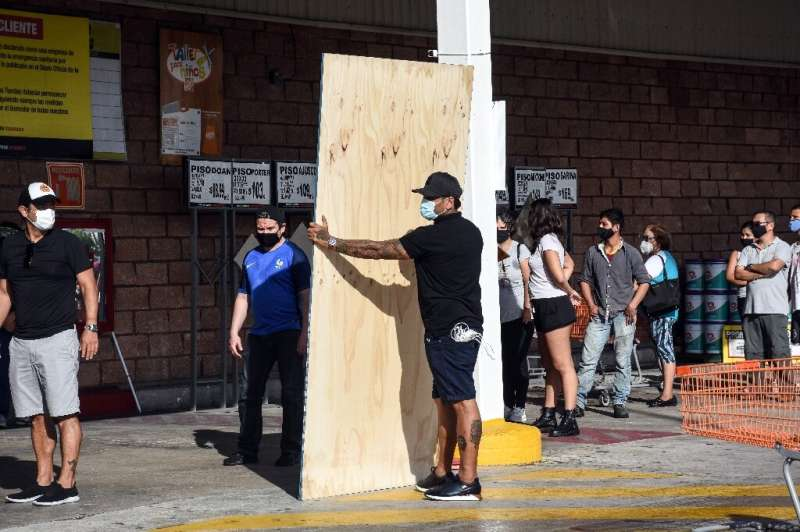 Cancun residents buy boards to protect their homes as Hurricane Delta barrels towards southeast Mexico
