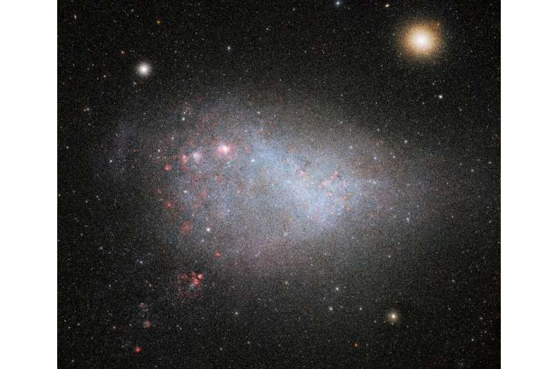 Dark energy camera snaps deepest photo yet of galactic siblings