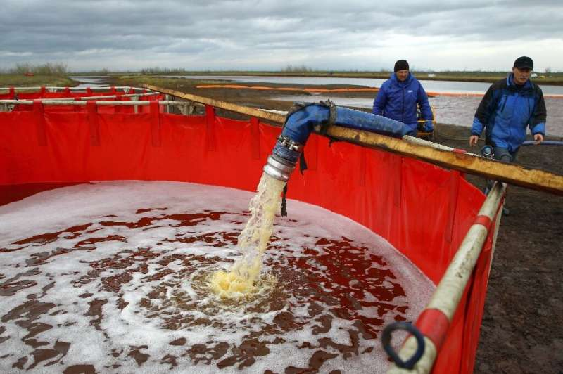 Employees of Russia's state-owned oil pipeline monopoly Transneft take part in the  clean-up operation after the massive fuel sp